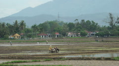 Asian man is plowing a ground with motor-block on the agricultural land of Stock Footage