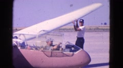 1964: people are seen preparing an aircraft for takeoff ELMIRA, NEW YORK Stock Footage