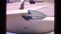 1964: guiding the plane on the runway before takeoff. ELMIRA, NEW YORK Stock Footage
