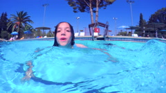 Underwater shot of kids swimming in a pool Stock Footage