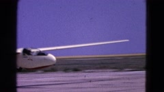 1964: small white airplane with large wing span taking off with the pilot Stock Footage