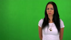 Young pretty woman disagrees - green screen - studio  Stock Footage