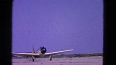 1964: various small airplanes, including a single propeller plane, taking off Stock Footage