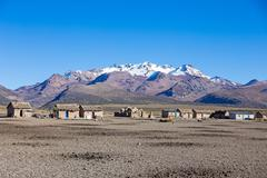 Small village of shepherds of llamas in the Andean mountains. Andean Highland Stock Photos