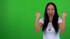 Young pretty woman rejoices - green screen - studio  Stock Footage