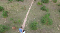Couple runs in a clearing in the woods. Shooting with quadrocopters. Dron. dji Stock Footage
