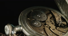 Macro shot of an Old pocket watch spinning Stock Footage