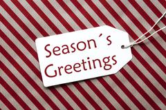 Label On Red Wrapping Paper, Text Seasons Greetings Stock Photos