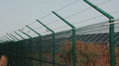 Steel Welded Solar Power Plant Security Solar. Mesh Fence. Fencing the territory Stock Footage