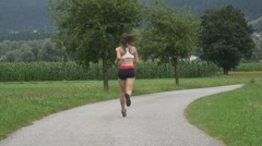 Woman running in a countryside Stock Footage