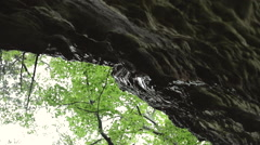 Cliff with Rain Dripping in Slow Motion Stock Footage