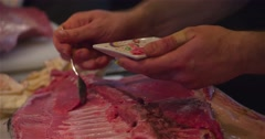 Chef cutting scraping bluefin tuna fish spoon 4k video sushi restaurant kitchen Stock Footage