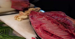 Chefs prepares bluefin tuna fish with spoon put into plate 4k video. Japanese Stock Footage
