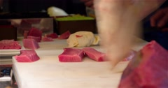 Raw tuna fish filet sushi restaurant kitchen 4k video: chefs cook preparing Stock Footage