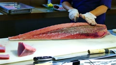 Chef cook hands cutting with knife bluefin tuna fish 4k video. Japanese cuisine Stock Footage