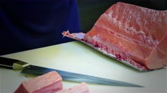 Chef cook hands cutting with knife tuna fish fillet 4k video. Japanese cuisine Stock Footage