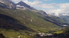 A small village in the mountainous regions of Alps, high amazing green hills Stock Footage