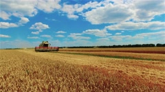 Thresher combine harvester reel cutter bars field. Farm vehicle 4k video. Stock Footage