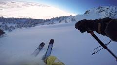 FPV: Freeride skier enjoying riding fresh powder snow and doing powder turns Stock Footage