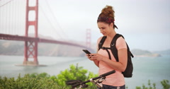 Young woman millennial using smartphone outdoors. Woman in her 20s using phone Stock Footage