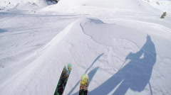 POV: Freeride skier riding powder snow and jumping over rocky mountain overhang Stock Footage