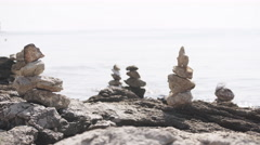 Balance stones on a beach of ocean. 4K Stock Footage