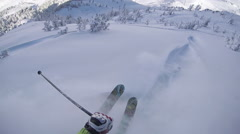 FPV: Extreme freeride skier skiing in fresh powder snow on a perfect winter day Stock Footage