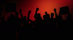 Crowd protesting on flashing red lights background Stock Footage