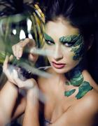 Woman with creative make up like snake and rat in her hands, halloween horror Stock Photos