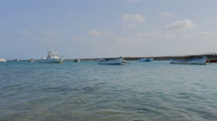 Fuerteventura- timelapse crystal clear waters flowing under moored boats Stock Footage