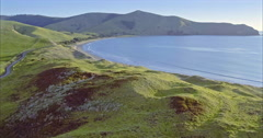 Aerial of farm land and beach in the Coromandel, New Zealand Stock Footage