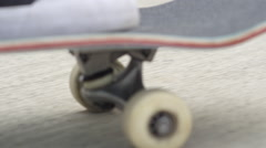 EXTREME CLOSE UP DOF: Unrecognizable skateboarder skating along the street Stock Footage