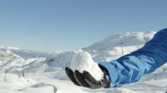 PORTRAIT: Cheerful snowboarder playing with snow in mountain ski resort Stock Footage