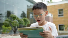 Boy playing games on tablet computer Arkistovideo