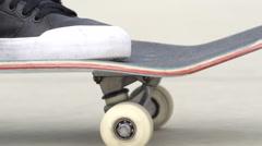 SLOW MOTION CLOSEUP: Unrecognizable man in sneakers skateboarding along a street Stock Footage