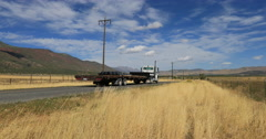 Rural road commercial truck pass mountain valley DCI 4K. Stock Footage