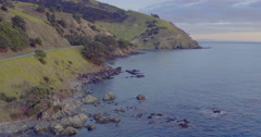 Aerial of remote farm, road & beach in the Coromandel, New Zealand Stock Footage