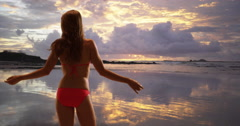 Sexy Woman standing at the beach admiring the sunset. Rear view of woman in her Stock Footage