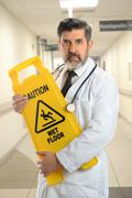 Hispanic Doctor Holding Caution Sign Stock Photos