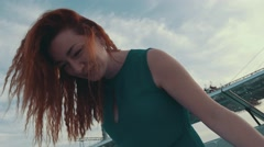 Red hair happy girl on motor boat. Laugh in camera. Summer. Entertainment Stock Footage