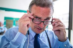 Portrait of doctor wearing spectacle at the hospital Stock Photos