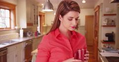 Young woman in her 20s drinking a cup of coffee at home before going to work. Stock Footage