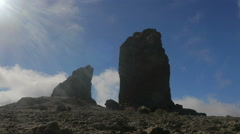 GRAN CANARIA- timelapse men walking near the ancient giant stones Stock Footage