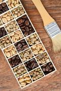 Different coffee forms in wooden box and brush Stock Photos