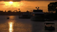 Two electric Duffy boats under sun setting while on motor boat cruising in ha Stock Footage