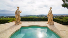 Time Lapse of Statues by Jacuzzi at Expensive Mansion in Newport Beach -Zoom In- Stock Footage