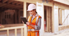 Young woman construction manager directing traffic in front of project. Stock Footage