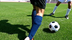 Footballer making tricks to avoid the defender, slow motion Stock Footage