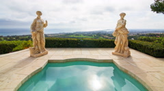 Time Lapse of Statues by Jacuzzi at Expensive Mansion in Newport Beach -Tilt Up- Stock Footage