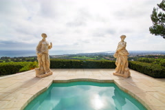 5K Time Lapse of Statues by Jacuzzi at Expensive Mansion in Newport Beach Stock Footage